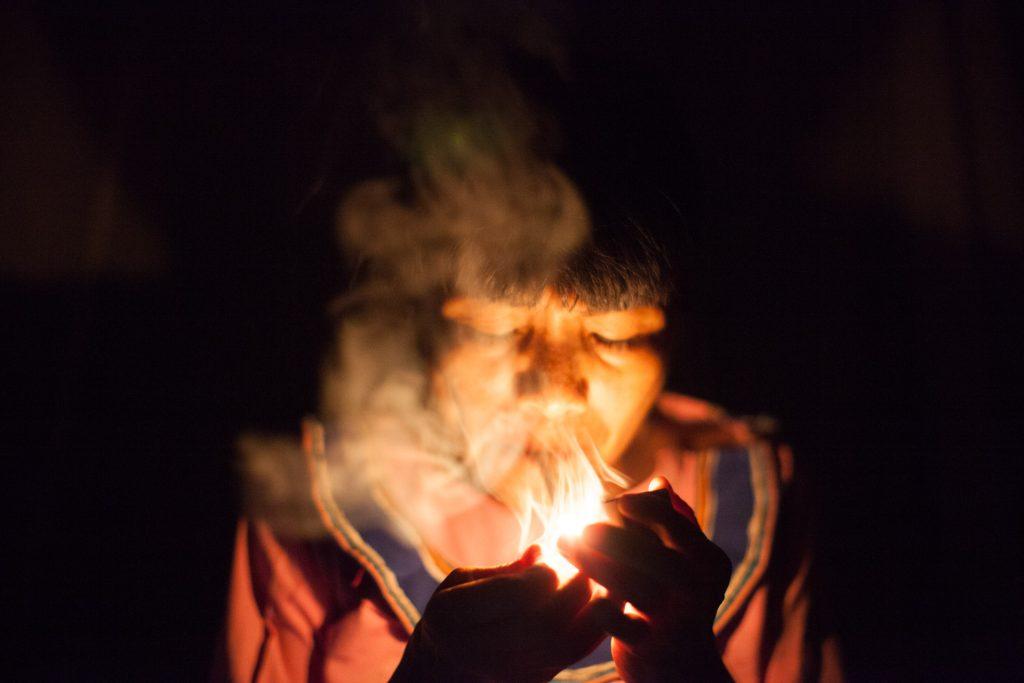 ayahuasca retreat peru shipibo curandera smoking pipe